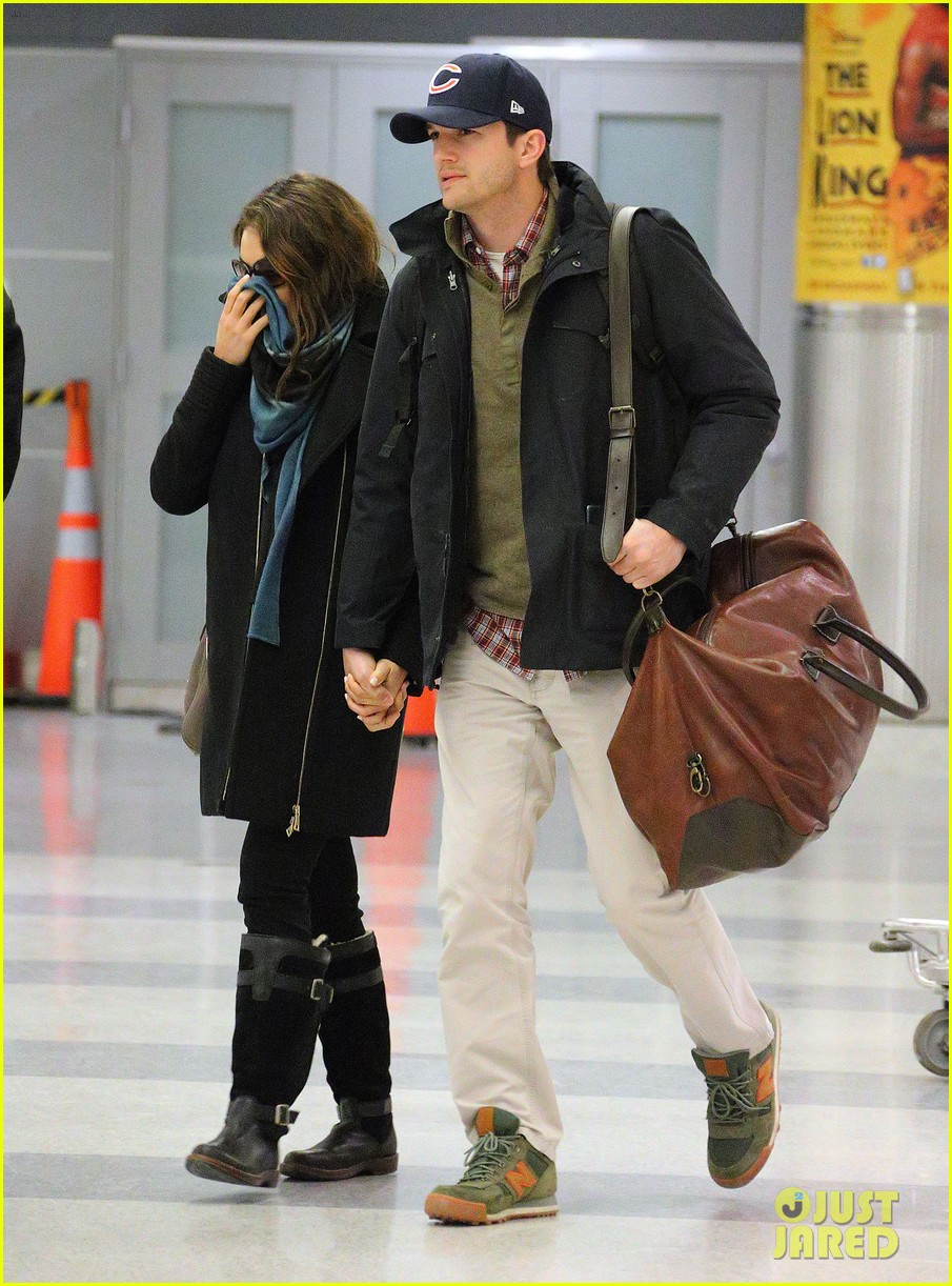 mila kunis ashton kutcher hold hands upon arrival in nyc 01