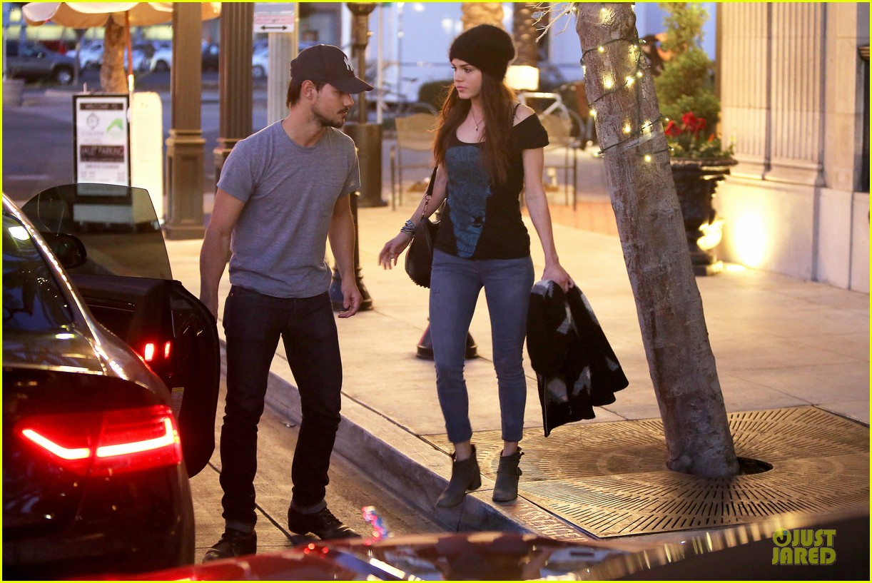 taylor lautner marie avgeropoulos hold hands for dinner 08