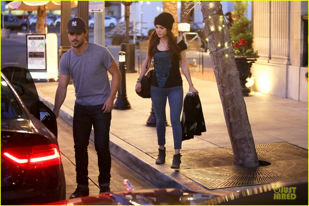 taylor lautner marie avgeropoulos hold hands for dinner 14