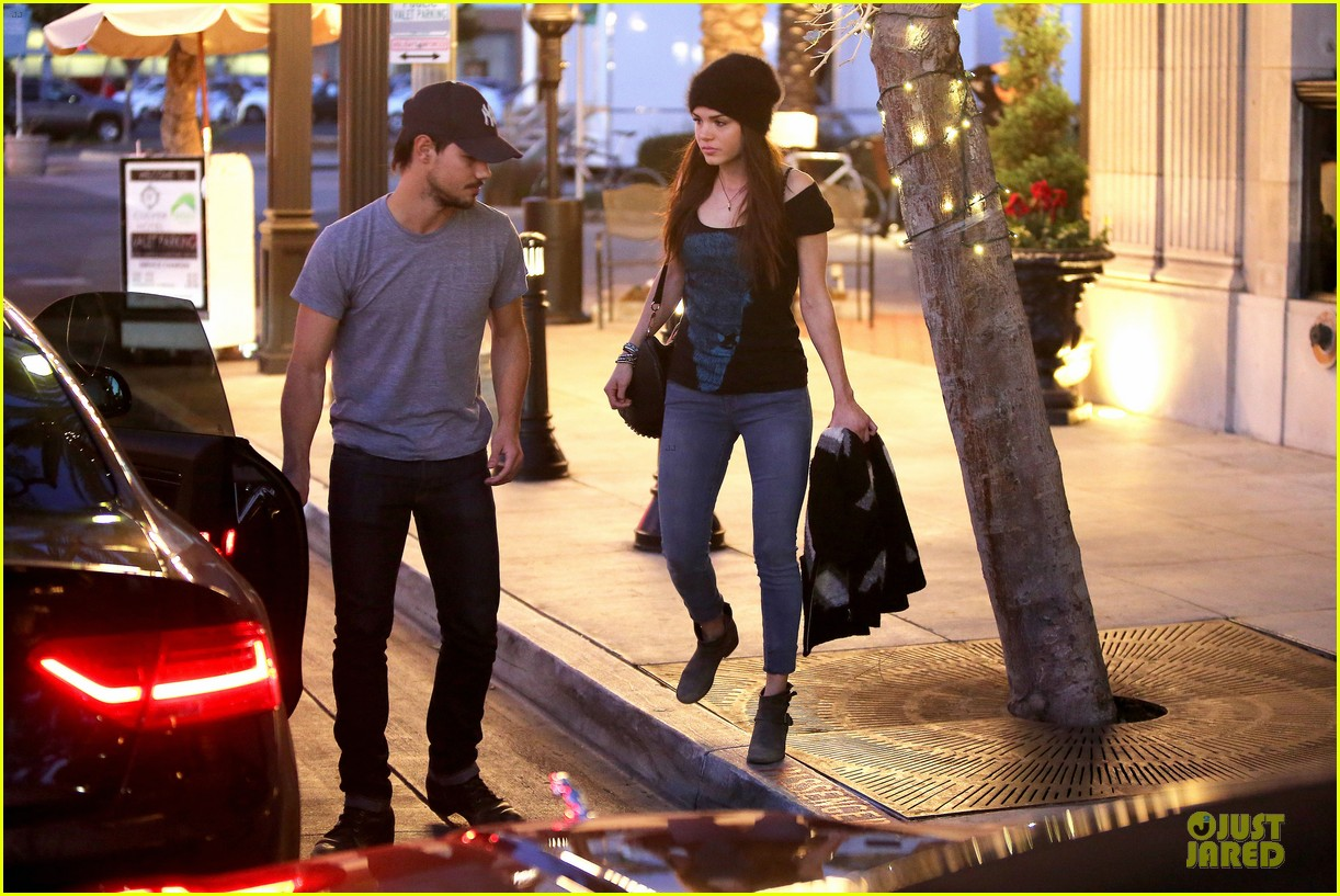taylor lautner marie avgeropoulos hold hands for dinner 15