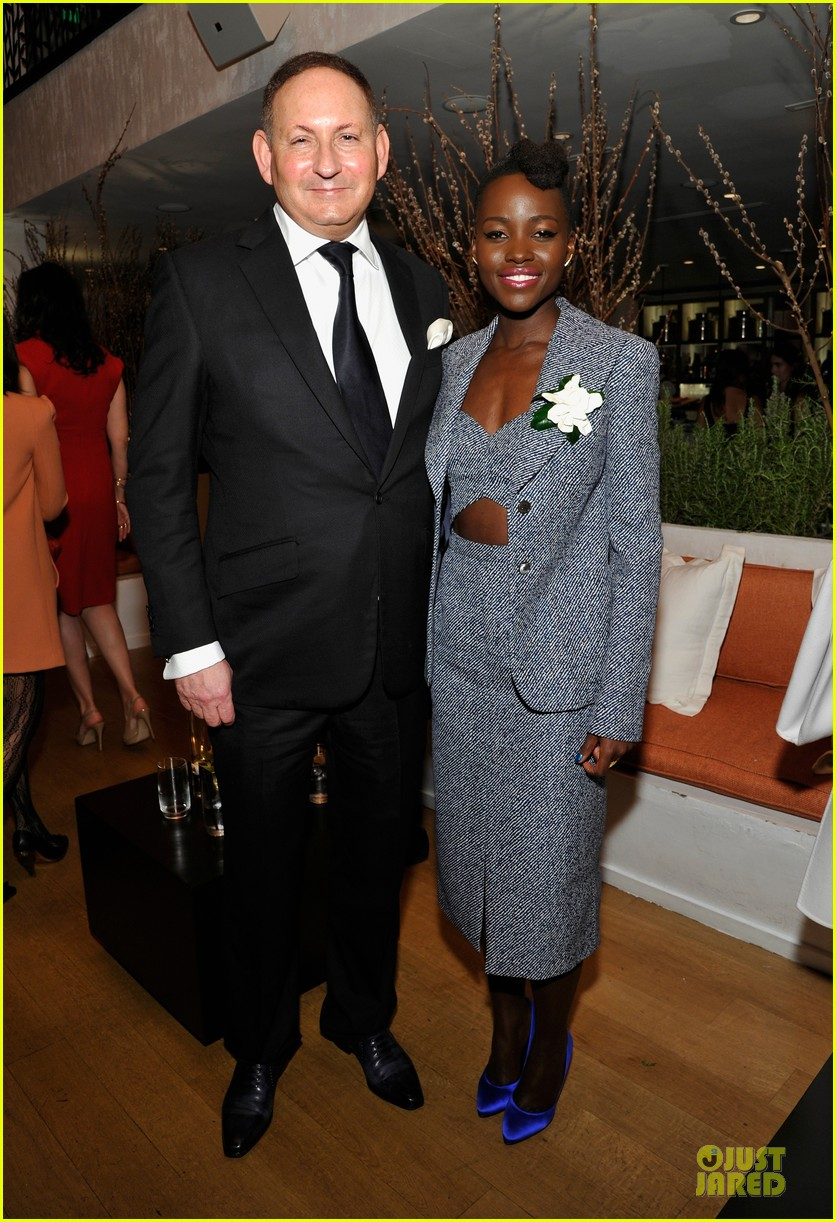 lupita nyongo helen mirren show admiration for each other at woemn in film pre oscar party 133062595