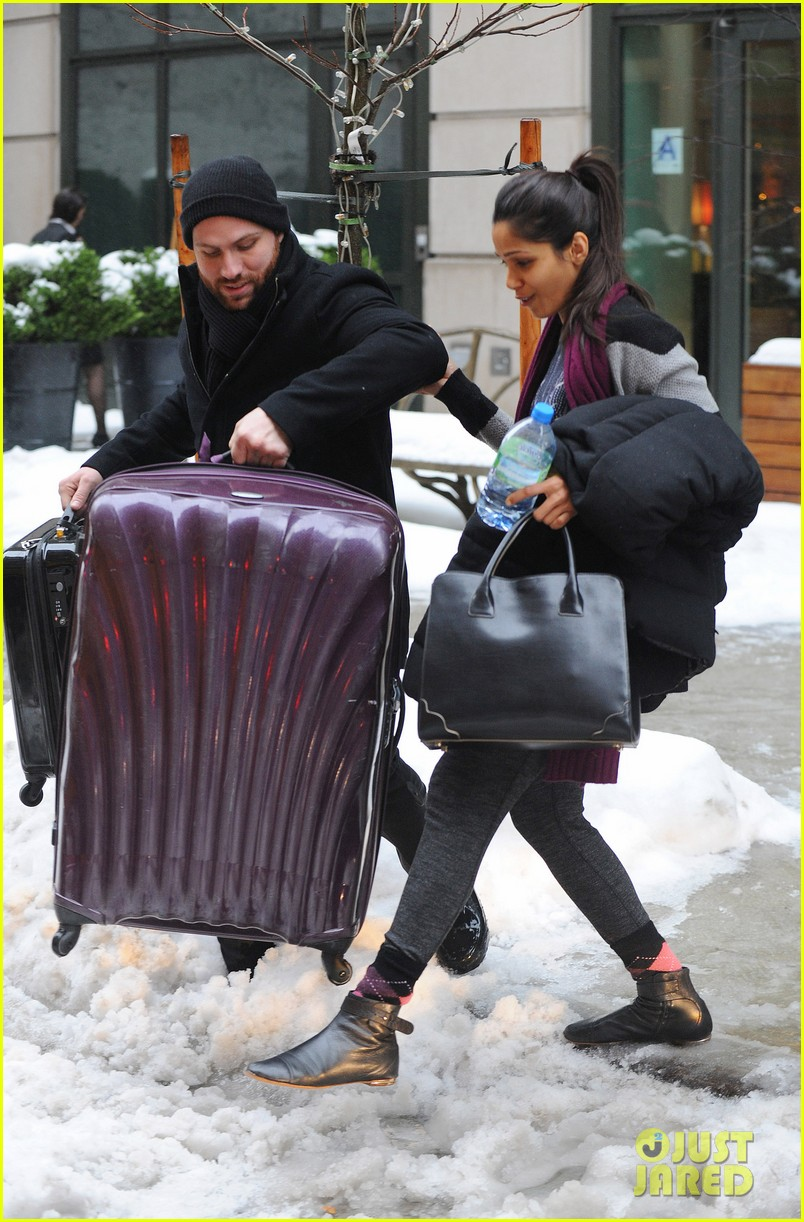 freida pinto laughs off giant snow slush piles in nyc 03