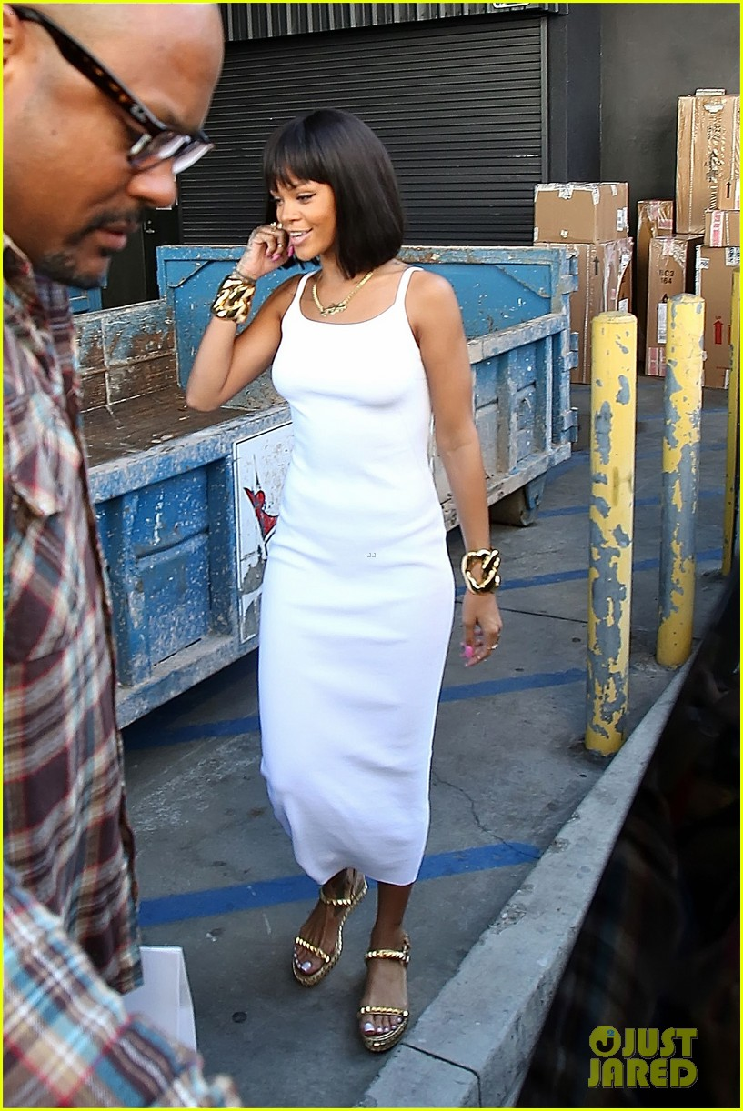 rihanna wears sleek white dress to shop at moncler 133055406