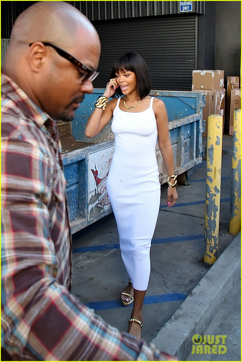rihanna wears sleek white dress to shop at moncler 14