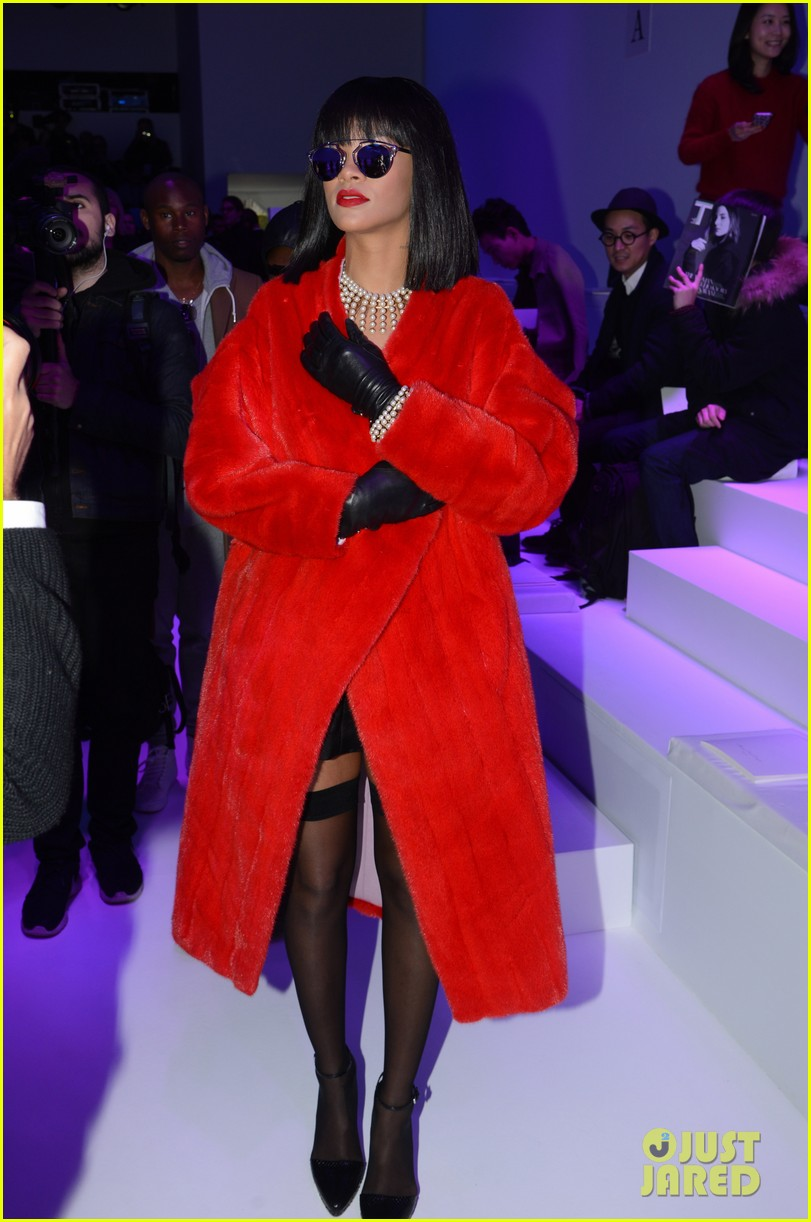 rihanna covers up sexy black outfit with red coat 07