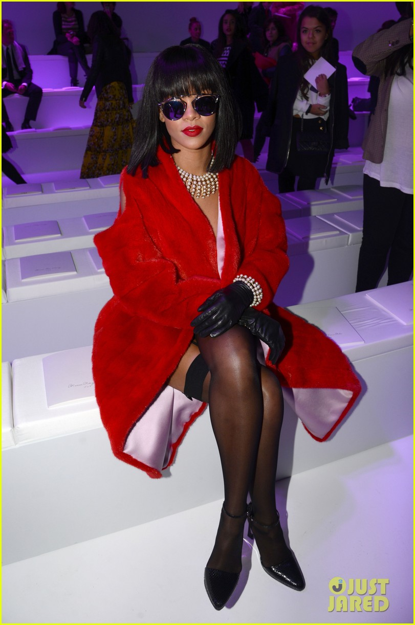rihanna covers up sexy black outfit with red coat 12