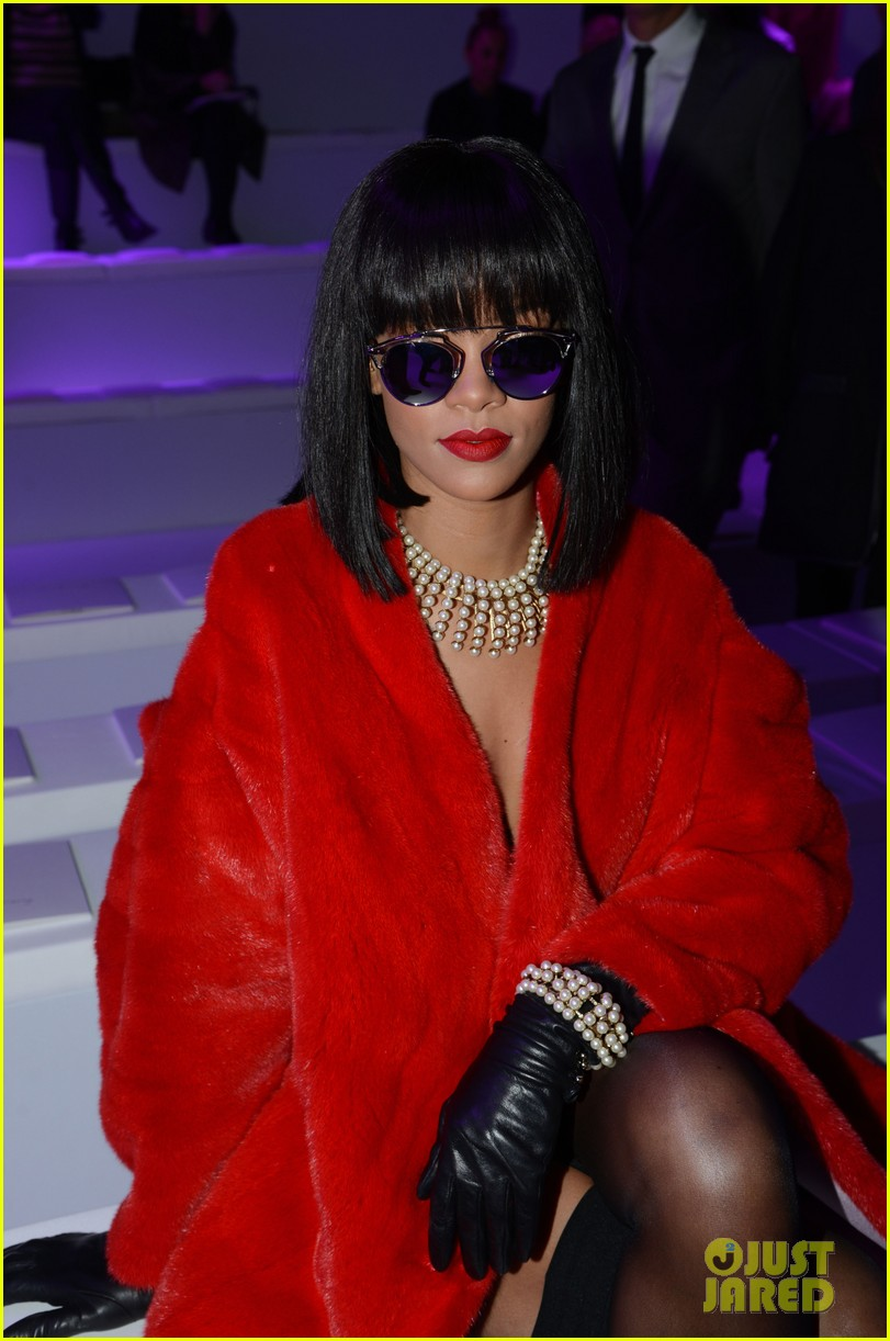 rihanna covers up sexy black outfit with red coat 16