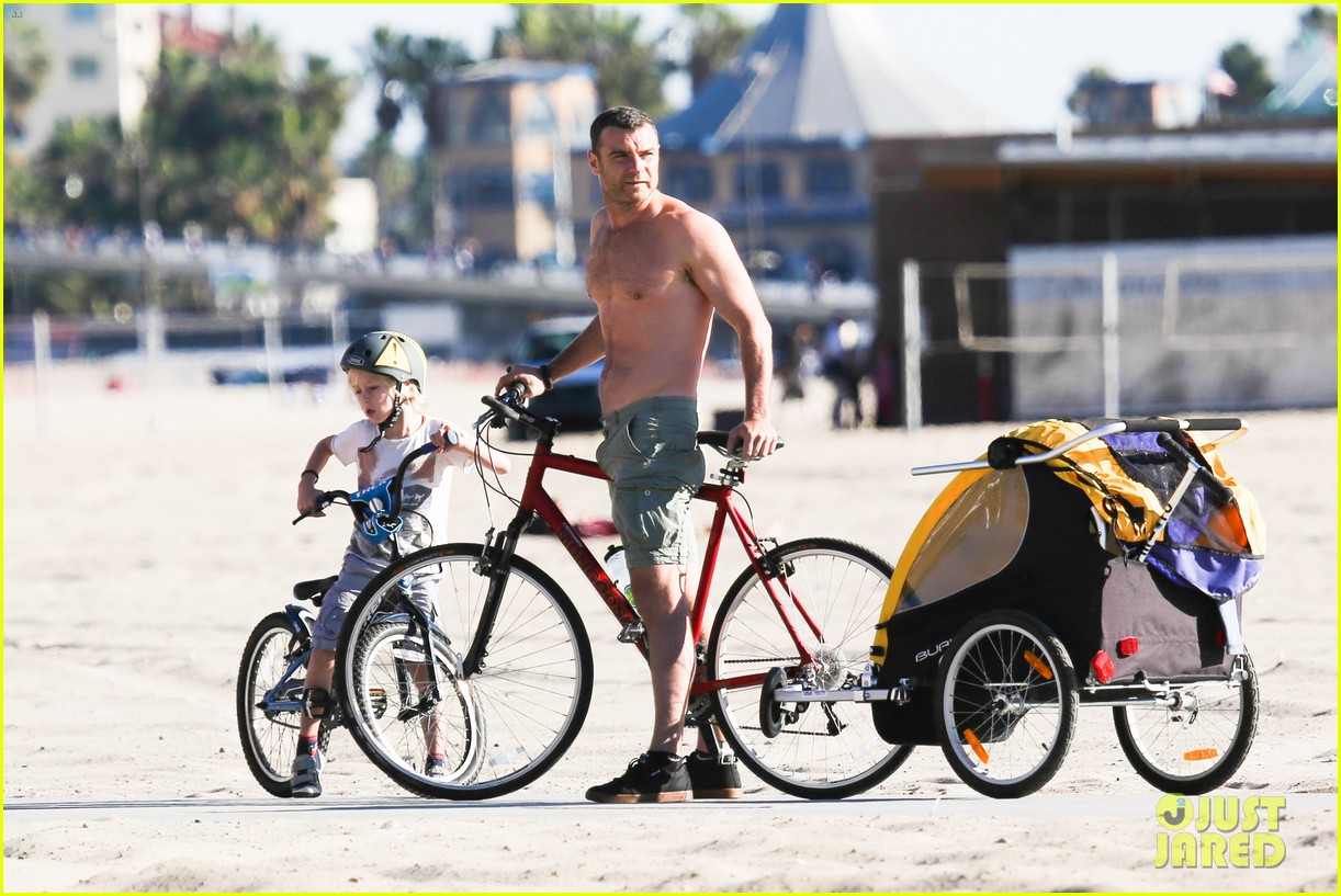 liev schreiber bares hot shirtless bod for family bike ride 02