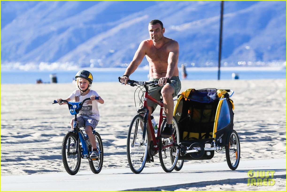 liev schreiber bares hot shirtless bod for family bike ride 303045889