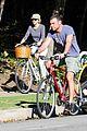 liev schreiber bares hot shirtless bod for family bike ride 16