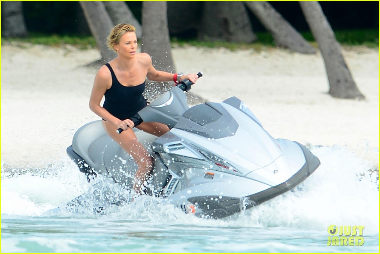 charlize therons bathing suit body is so enviable during jet ski shoot 09