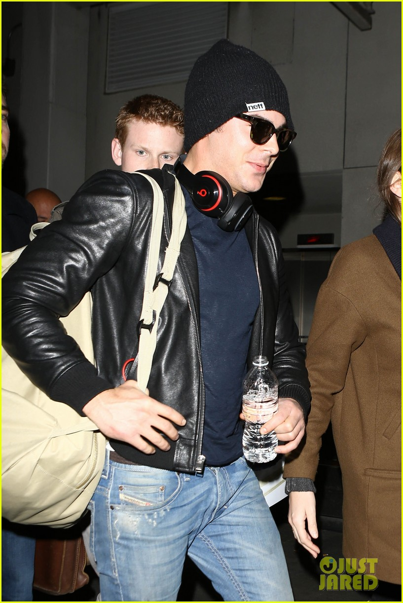 zac efron ashton kutcher fly out of austin after sxsw 28