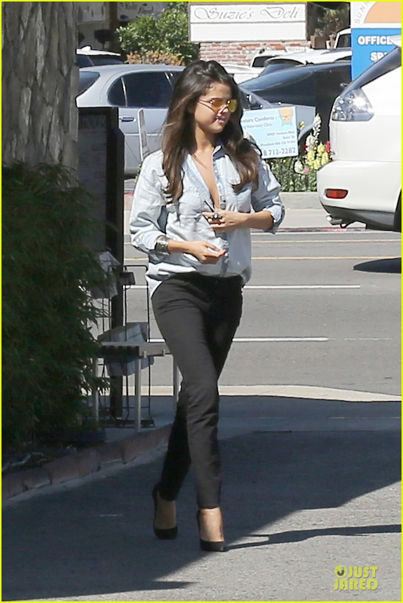 selena gomez teases us with low denim buttoned shirt 24