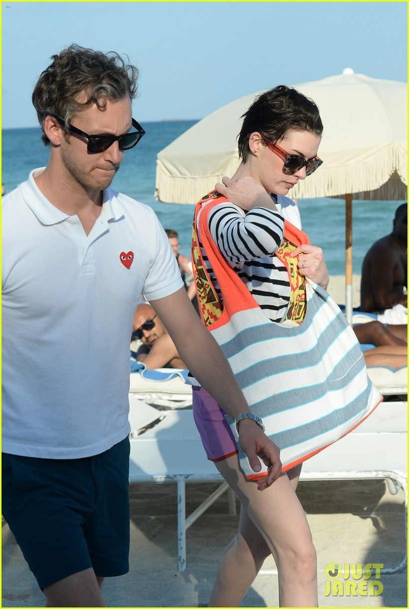 anne hathaway heads back for more beach fun in miami 043077317