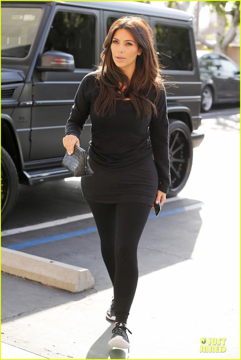 kim kardashian makes a very dark entrance at production office 01