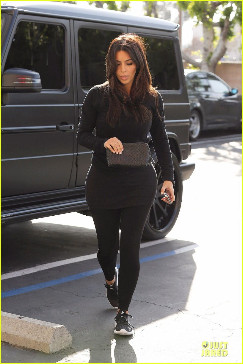 kim kardashian makes a very dark entrance at production office 17