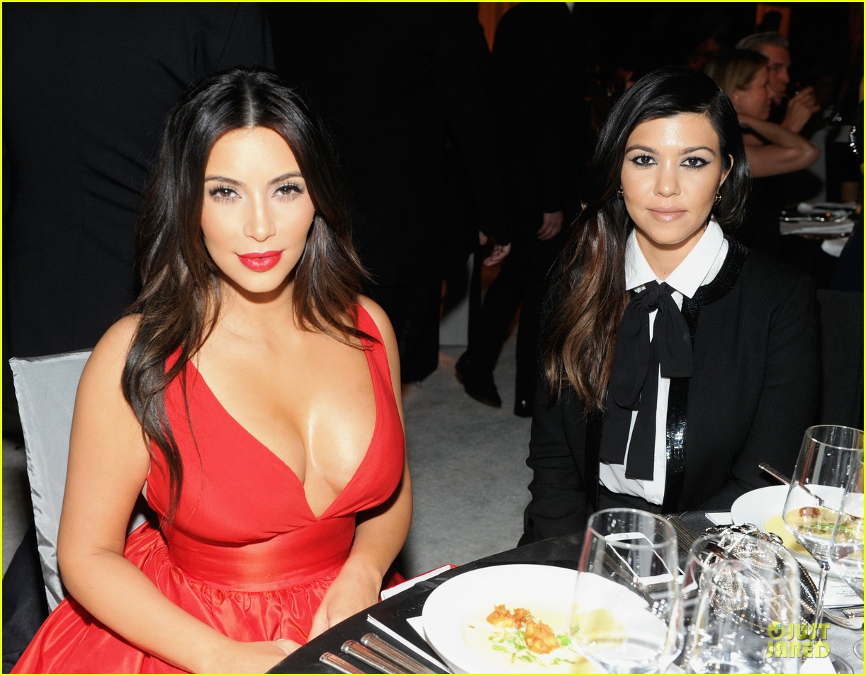 kim kardashian bares cleavage in red dress at elton john oscars party 2014 04