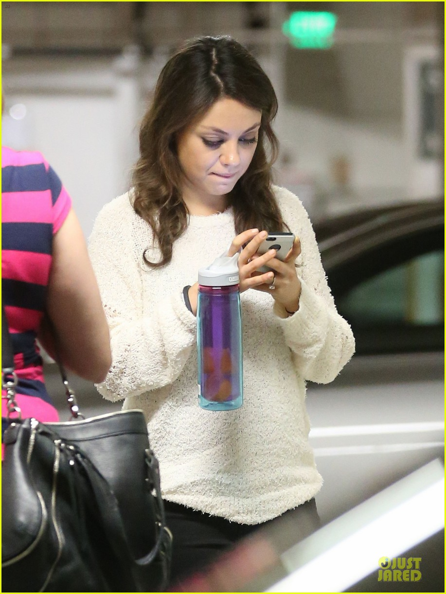 mila kunis brightens up the day with shopping 10