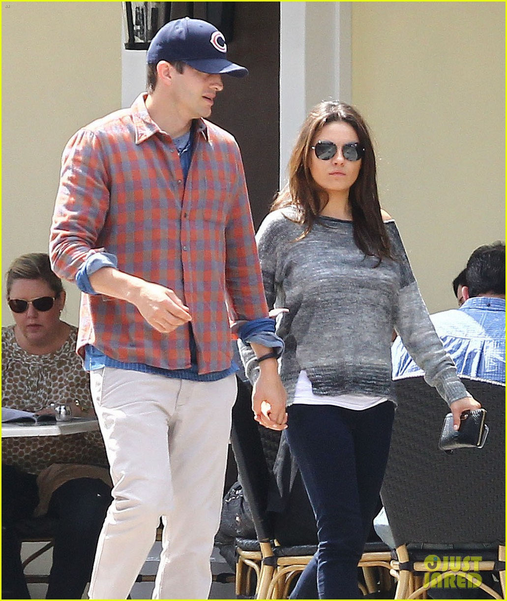 mila kunis ashton kutcher hold hands pregnancy rumors 043076724