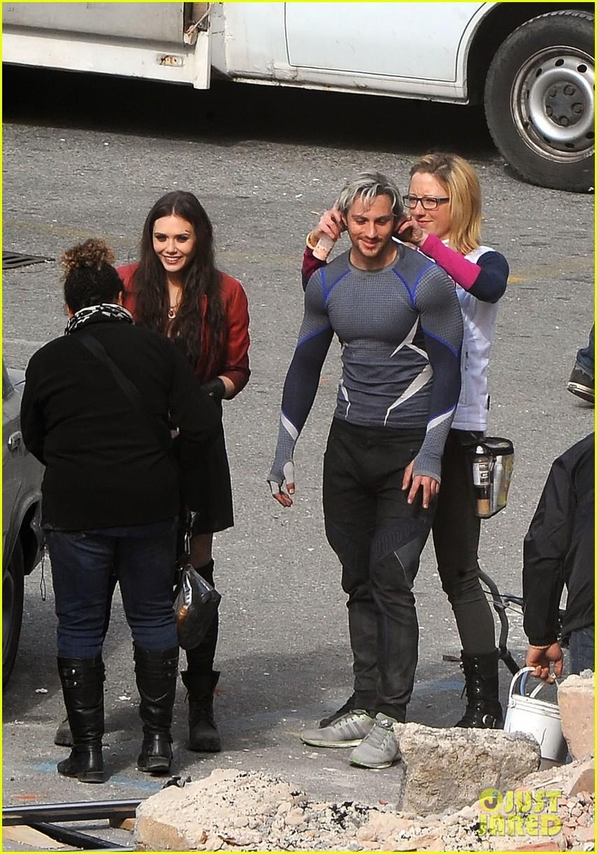 elizabeth olsen aaron taylor johnson get touched up avengers 08