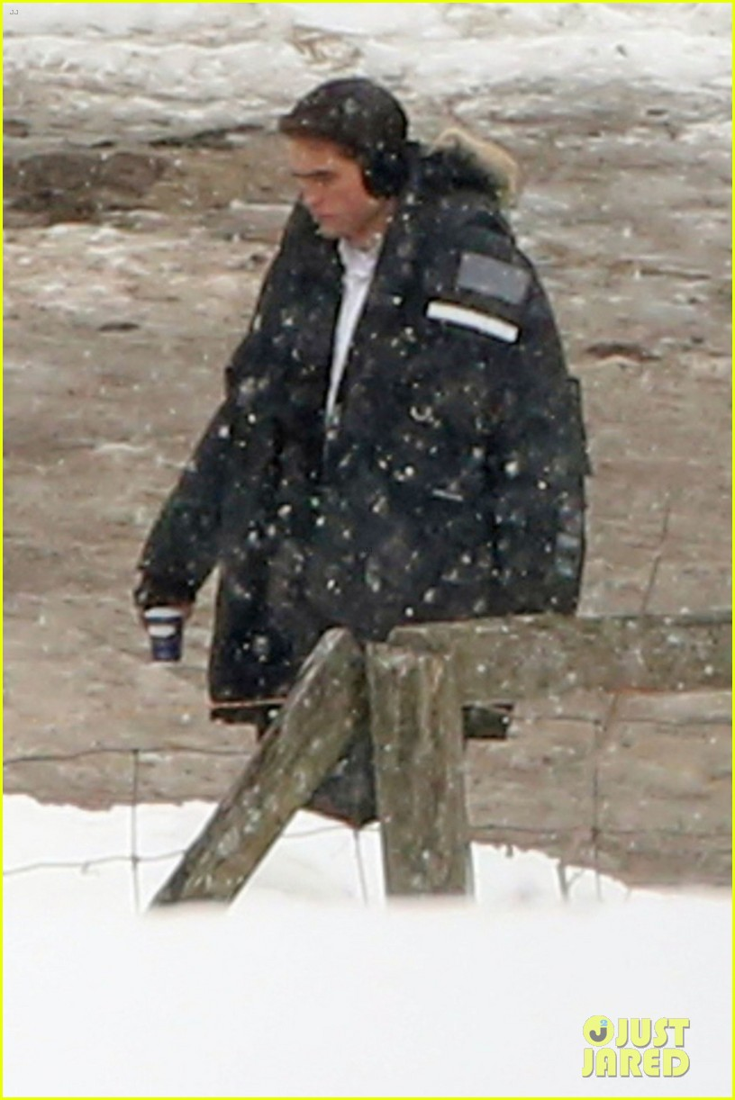 robert pattinson keeps warm with earmuffs on snowy life set 02