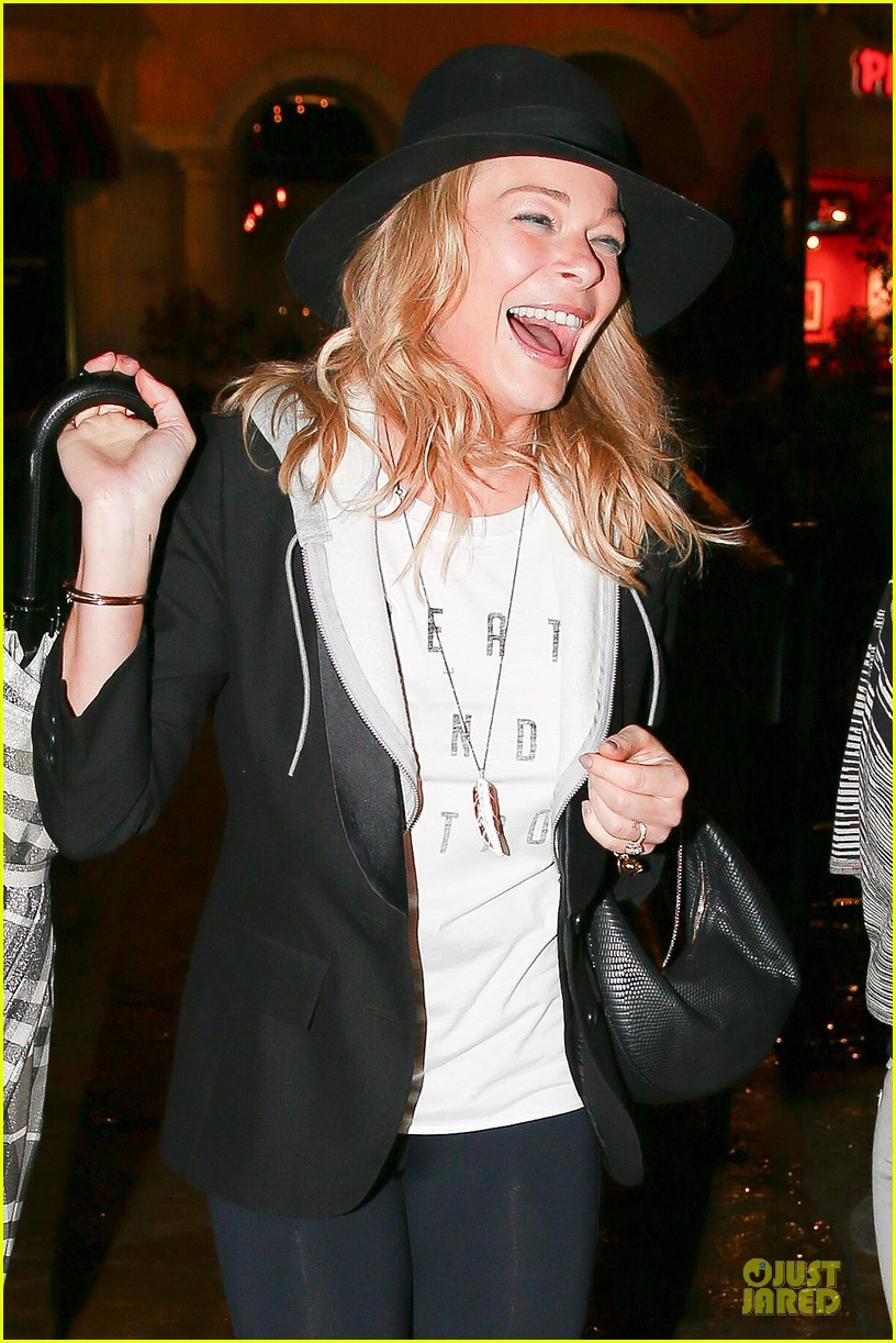 leann rimes fights rain storm with umbrella at tosconova restaurant 04