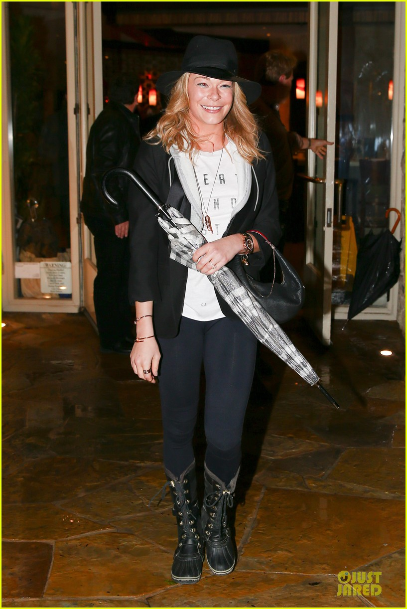 leann rimes fights rain storm with umbrella at tosconova restaurant 10