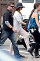 jennifer aniston hides face under a hat 13