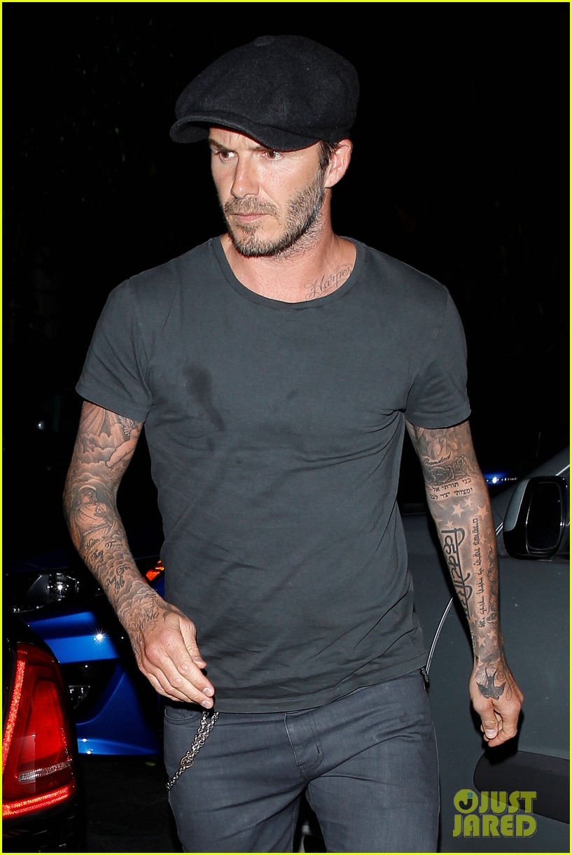 chivalry isnt dead for david beckham as he opens car door for victoria beckham 023086864