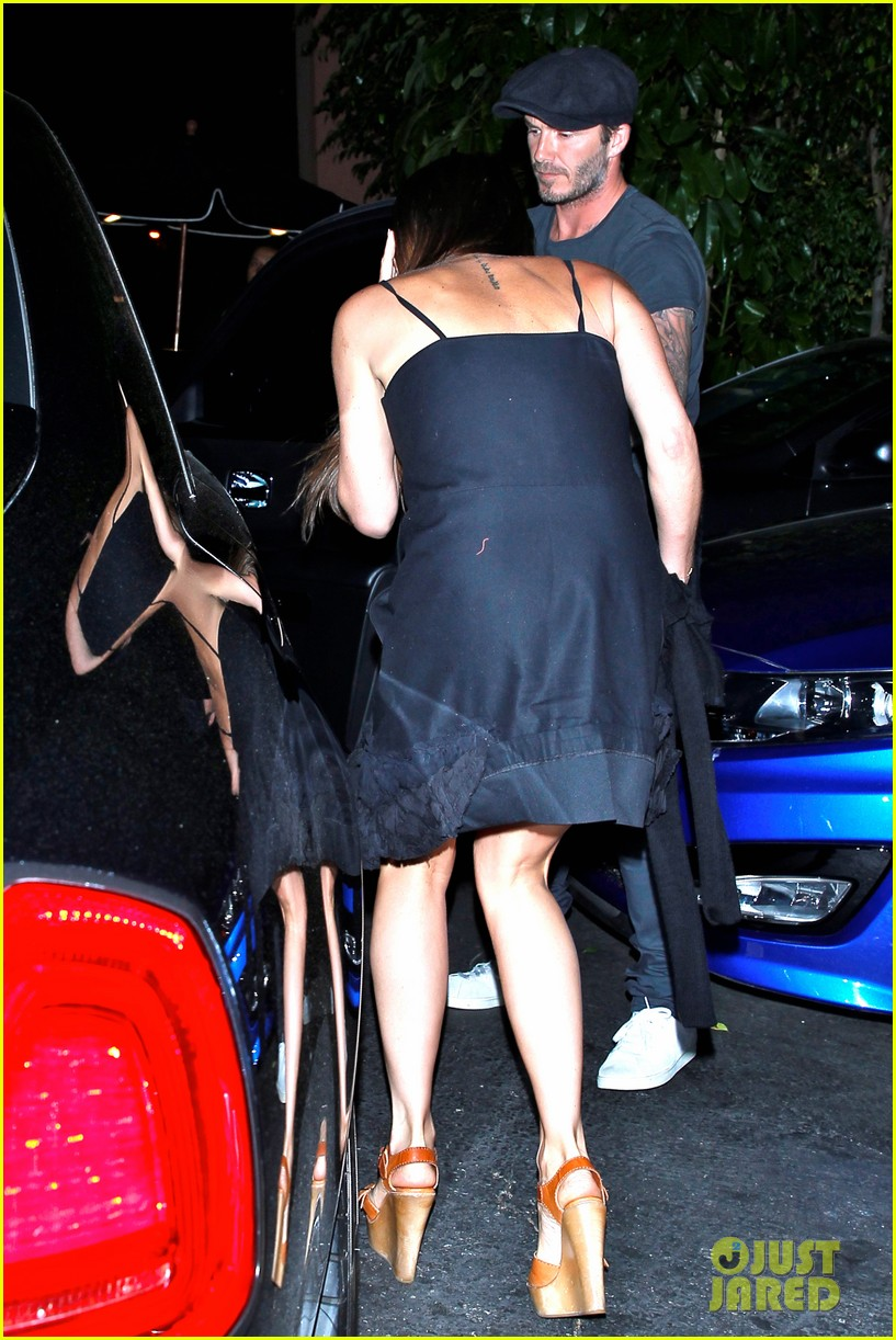 chivalry isnt dead for david beckham as he opens car door for victoria beckham 083086870