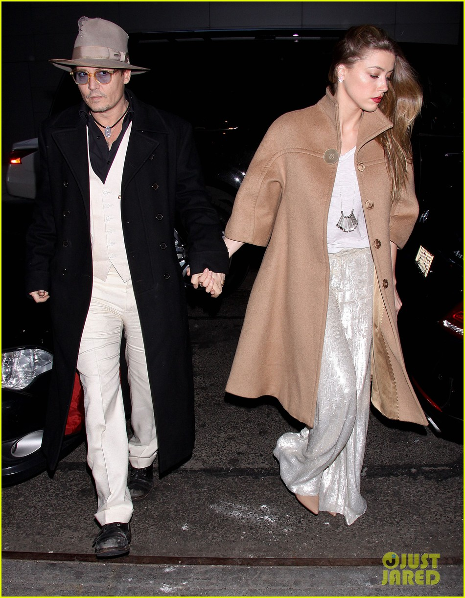johnny depp amber heard hold hands at cabaret opening 033098560