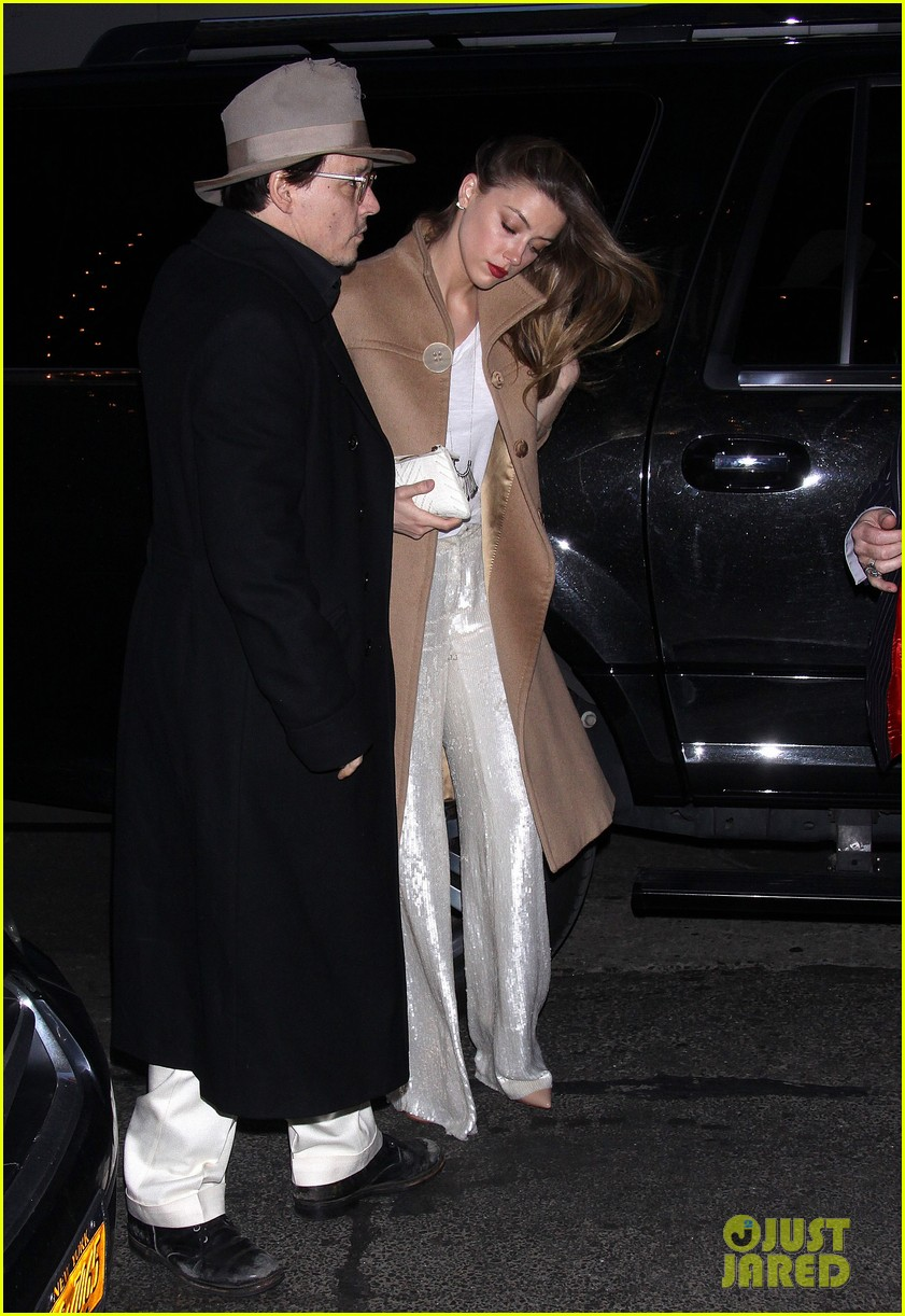 johnny depp amber heard hold hands at cabaret opening 073098564