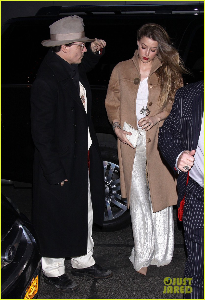 johnny depp amber heard hold hands at cabaret opening 083098565