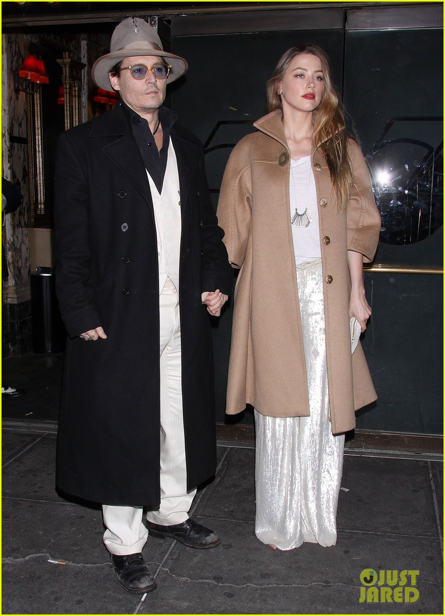 johnny depp amber heard hold hands at cabaret opening 15