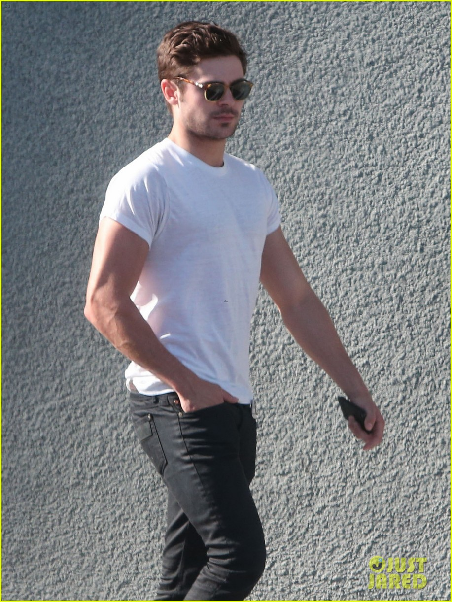 zac efron toned arms shopping guitars 083084138
