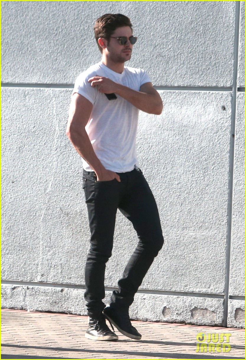zac efron toned arms shopping guitars 103084140