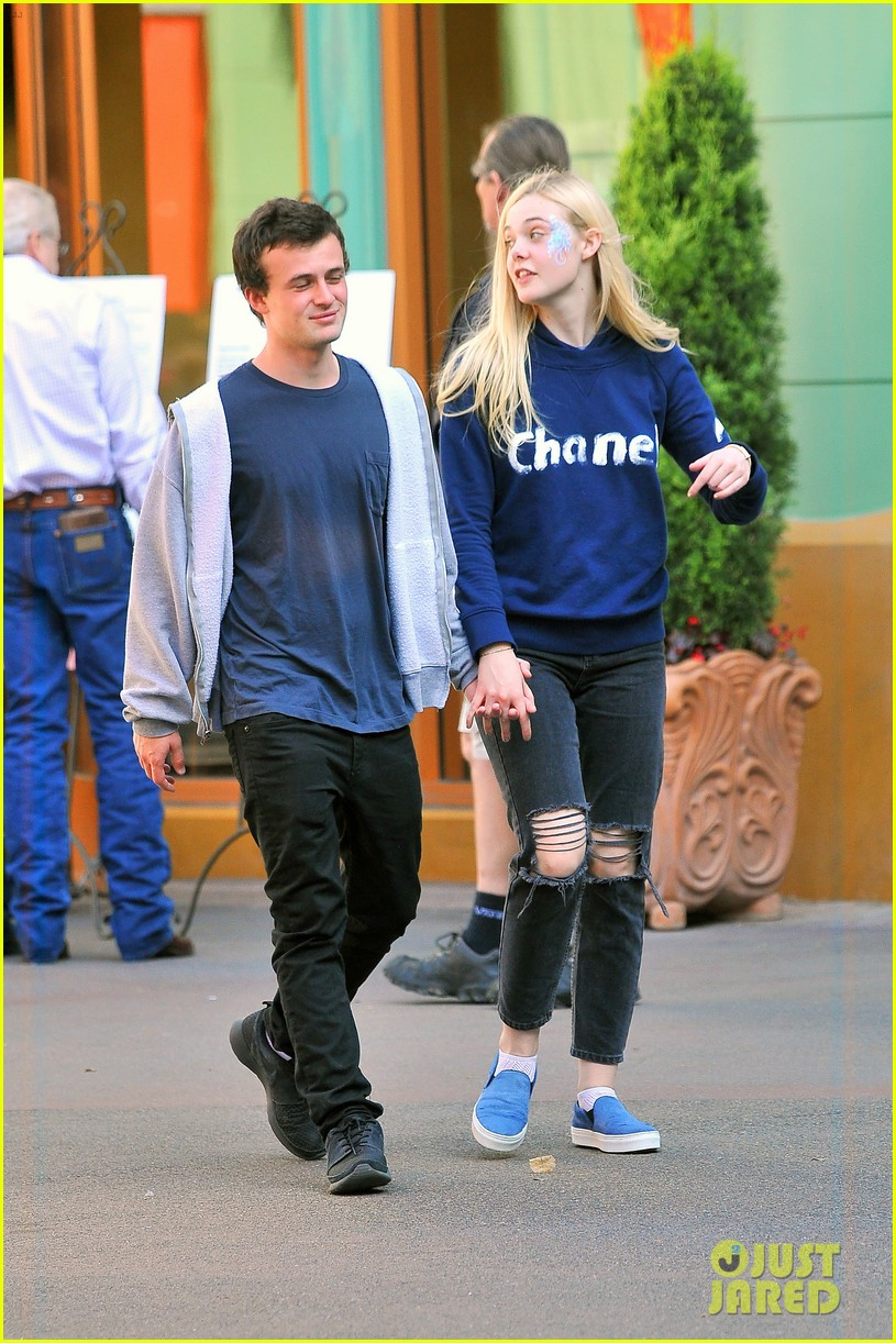 elle fanning boyfriend hold hands at disneyland 013089944