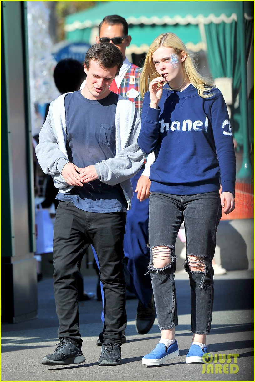 elle fanning boyfriend hold hands at disneyland 083089951