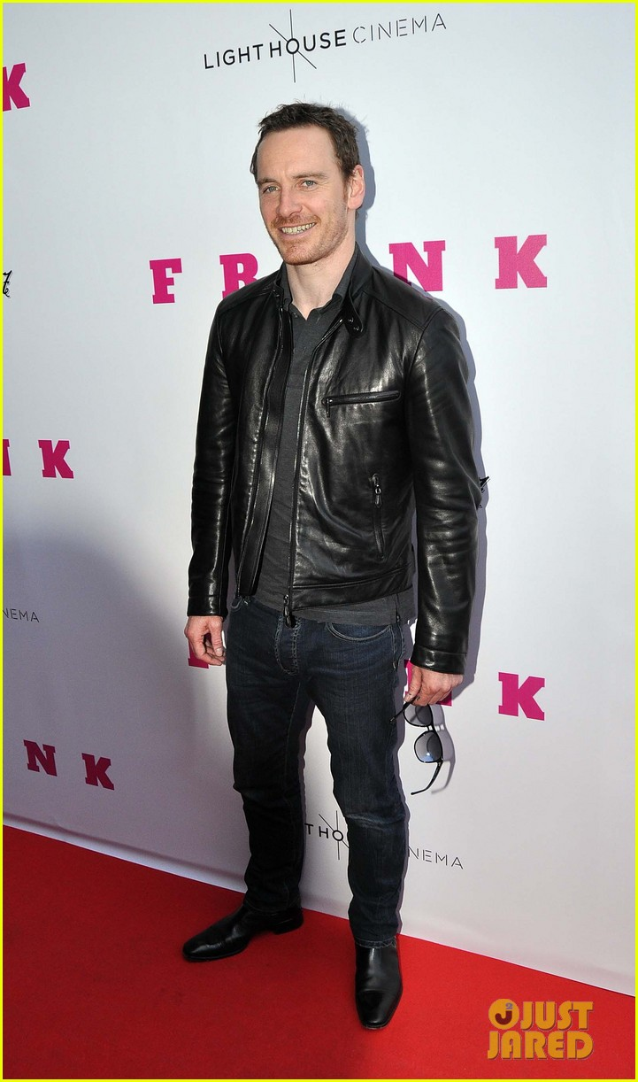 michael fassbender works the red carpet in a leather jacket 023098308