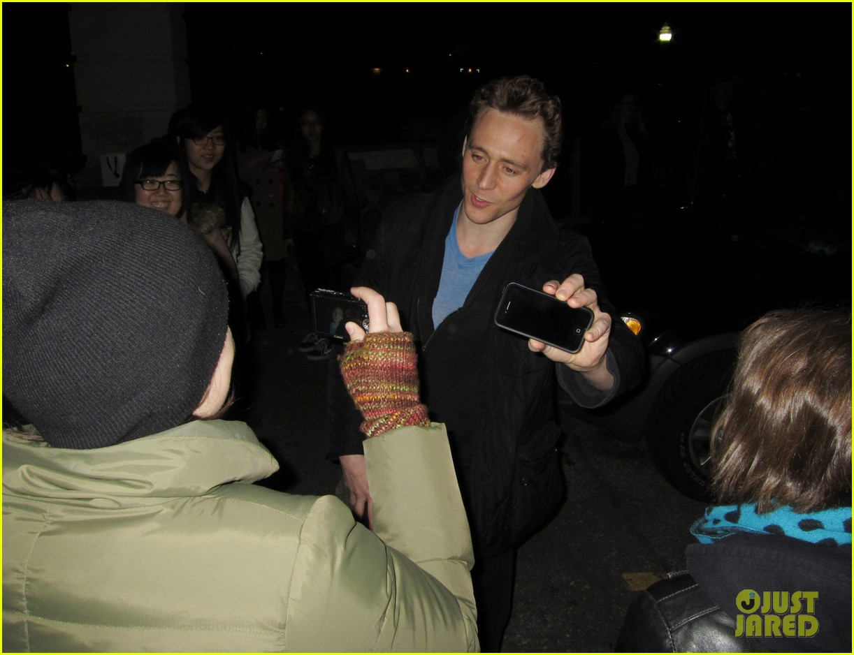 tom hiddleston happily accepts stuffed monkey gift 04