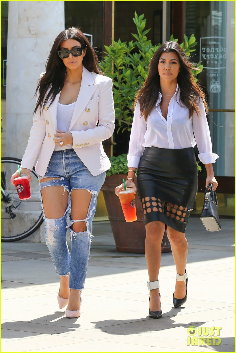 kim kardashian wears jeans with giant rips in them 013096293