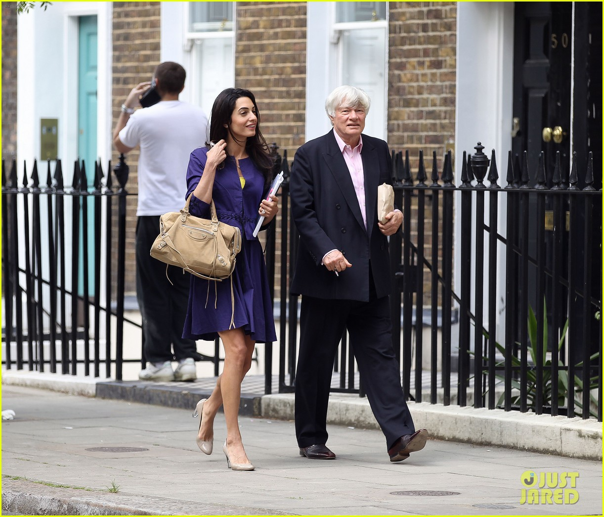 george clooneys fiancee amal alamuddin is back at work 11