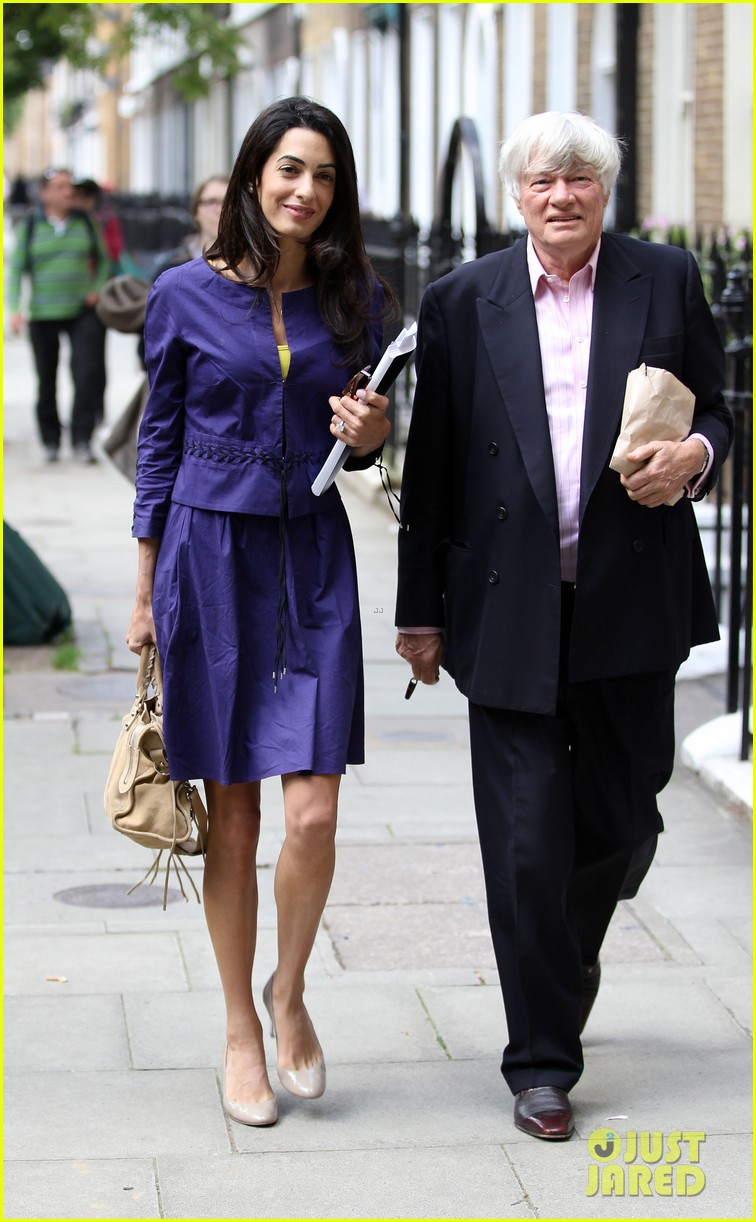 george clooneys fiancee amal alamuddin is back at work 163114485