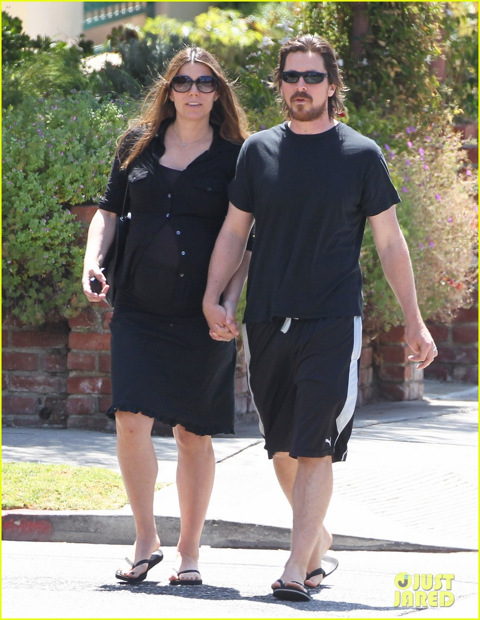 christian bale pregnant wife sibi hold hands 173119697