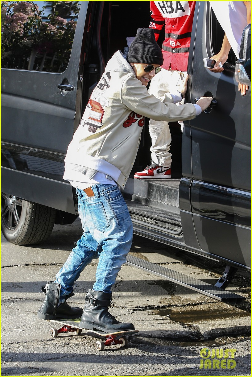 justin bieber holds onto van while riding skateboard 06