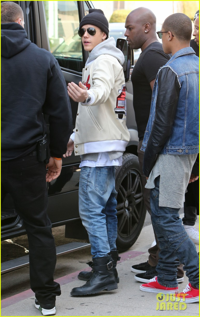 justin bieber holds onto van while riding skateboard 253110473