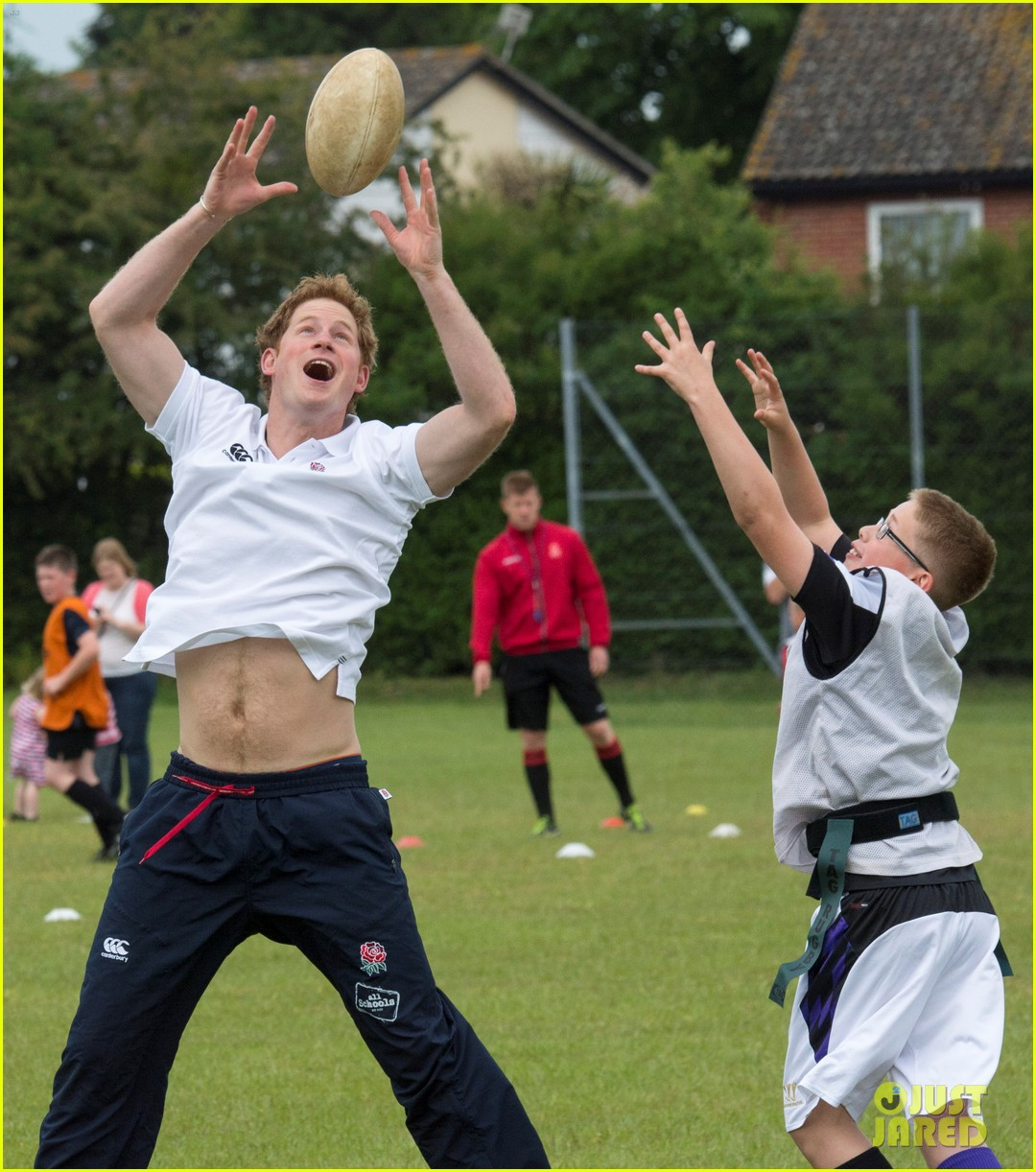 prince harry plays rugby schoolkids flashes his abs in the process 133123866