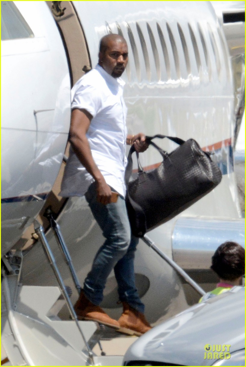 kim kardashian kanye west land in florence before wedding 03