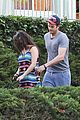 mila kunis hides her baby bump in loose fitting dress 09