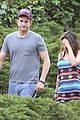 mila kunis hides her baby bump in loose fitting dress 31